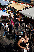 Busy summer day at Camden Market, North London. Camden Lock is a crowded hang out for young Londoners.