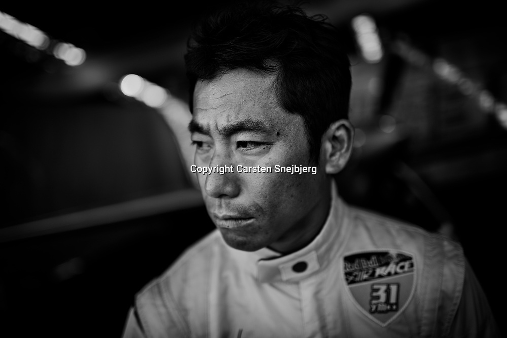 Yoshihide 'Yoshi' Muroya on the race day. In the pit, his crew readies his aircraft for the competition.
