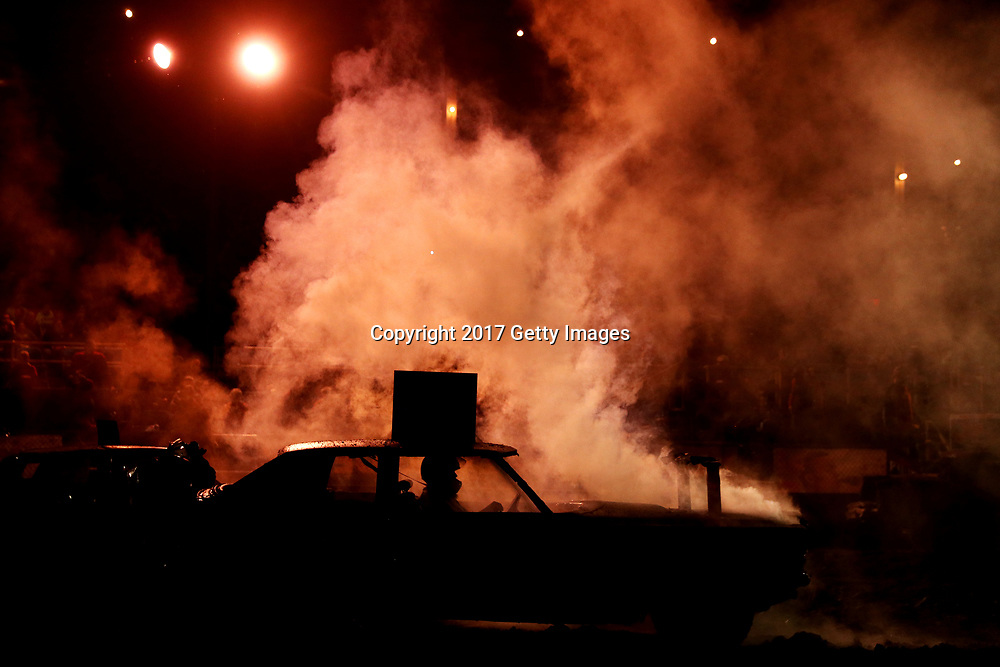 Smoke rises from a car during the 8 cylinder competition during the Vermont State Championship Demolition Derby at the Vermont State Fairgrounds on September 9, 2017 in Rutland, Vermont.