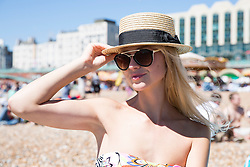 © Licensed to London News Pictures. 06/08/2016. Brighton, UK. 24 year old Anna from Belarus joins thousands of people who take to the beach in Brighton to swim and sunbathe as warm weather and sunshine is hitting the seaside resort. Photo credit: Hugo Michiels/LNP