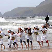 """31-8-09WEST KERRY: """"Gimme back my fish""""l aughs chef Jean marie Vaireaux as he chases children, Ella Greely, Natasha Vaireaux, Margot Vaireaux, Jack brick, Hanna and Rachel Rubinstein, Ciara Brick and Faye Greely across Coomeenole Strand in West kerry at the launch of the 2009 Blas na hEireann Food Awards which will take place in Dingle County Kerry Oct 2-4th. <br /> Picture by Don MacMonagle<br /> Now in its second year, these Awards attracted over 800 product entries from 300 producers throughout the country, North and South, in 2008.  The Blas Awards are the only Irish food awards that focus solely on taste, arguably the most important criteria for a food product, and the judging standards are the most rigorous in the country. Winners are chosen as a result of blind tastings where like products are pitched against each other in a battle to tickle the tastebuds of the country's top food experts.   This year there are 30 categories for producers to enter, ranging from cheese and chocolate to ice cream and black pudding.  The winners of each category will then do battle for the prestigious title of overall Producer of the Year 2009. Winners will be announced on the 2nd October as part of the hugely successful Dingle Peninsula Food & Drink Festival www.dinglefood.com  , which will include a special expo of all Gold, Silver and Bronze winners for buyers, press and the general public."""