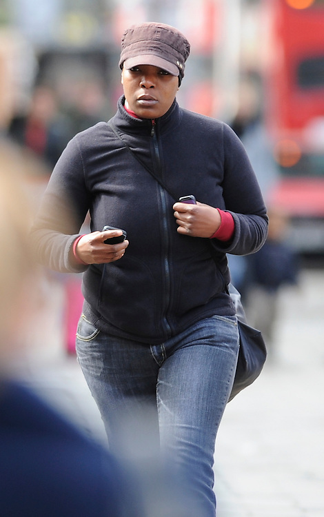 Lavinia Desuze, 31 arrives at Inner London Crown Court on April 17th 2012..Mother of Darrell Desuze   destroyed her sons clothes following the killing of Richard Mannington Bowes, 68, in Ealing, West London, in  the London Riots in  August 2011..Desuze  convicted of perverting the course of justice. The offence carries a maximum sentence of life in prison will be sentenced today..Her son Darrell will also be sentenced today for murder..Photo  Ki Price.