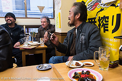 Out for lunch during setup day of the Annual Mooneyes Yokohama Hot Rod and Custom Show set-up day. Japan. Saturday, December 6, 2014. Photograph ©2014 Michael Lichter.