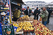Signs of the four-year siege of Sarajevo are still obvious today. Although food stalls have returned to the Ciglane market parts of the Olympic park behind it have become a burial ground for siege victims. Hungry Planet: What the World Eats (p. 49). This image is featured alongside the Dudo family images in Hungry Planet: What the World Eats.