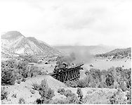 """D&RGW #488 southbound with a freight for Farmington just south of Durango.<br /> D&RGW  Carbon Junction, CO  Taken by Krause, John - 6/1952<br /> In book """"Durango: Always a Railroad Town (1st ed.)"""" page 125<br /> Also in """"Narrow Gauge News (CRA #21)"""", p. 156; """"Twilight on the Narrow Gauge"""", p. 7 and """"American Narrow Gauge"""", p. 120."""