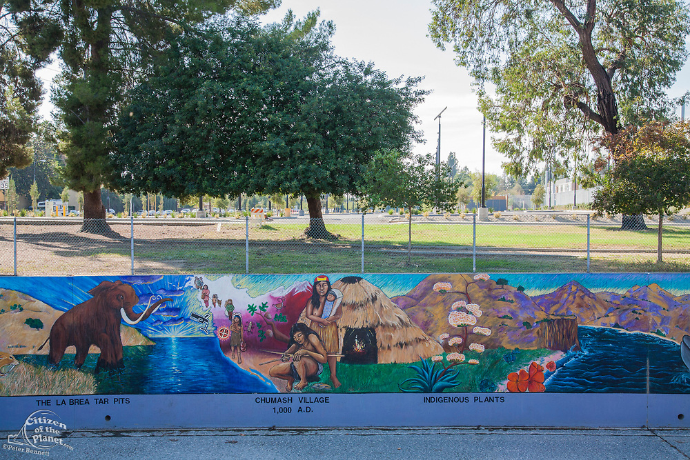 The Great Wall of Los Angeles is a mural designed by Judith Baca and executed with the help of over 400 community youth and artists, Tujunga Wash, Los Angeles, California, USA