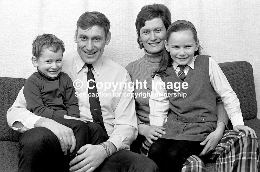 Irish International rugby player, Willy John McBride, pictured with his wife, Penny, son Paul (3½ yrs), and Amanda (5½ yrs) at their Ballyclare home, N Ireland, UK, a week before his record-breaking 54th international appearance. 197401110013b.<br /> <br /> Copyright Image from Victor Patterson, Belfast, UK<br /> <br /> t: +44 28 9066 1296 (from Rep of Ireland 048 9066 1296)<br /> m: +44 7802 353836<br /> e: victorpattersonbelfast@gmail.com<br /> <br /> www.images4media.com<br /> <br /> Please see my full Terms and Conditions of Use at https://www.images4media.com/p/terms-conditions - it is IMPORTANT that you familiarise yourself with them.<br /> <br /> Images used online incur an additional cost. This cost should be agreed in writing in advance. Online images must be visibly watermarked i.e. © Victor Patterson or that of the named photographer within the body of the image. The original metadata must not be deleted from images used online.<br /> <br /> This image is only available for the use of the download recipient i.e. television station, newspaper, magazine, book publisher, etc, and must not be passed on to a third party. It is also downloaded on condition that each and every usage is notified within 7 days to victorpattersonbelfast@gmail.com.<br /> <br /> The right of Victor Patterson (or the named photographer) to be identified as the author is asserted in accordance with The Copyright Designs And Patents Act (1988). All moral rights are asserted.