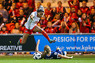 Eseosa Aigbogun (#19) of Switzerland hurdles over Erin Cuthbert (#22) of Scotland during the 2019 FIFA Women's World Cup UEFA Qualifier match between Scotland Women and Switzerland at the Simple Digital Arena, St Mirren, Scotland on 30 August 2018.