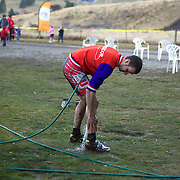 Riders clean up after the New Zealand Cyclocross Championships sponsored by AJ Hackett Bungy, held at Jardine Park,  Queenstown, as part of the Queenstown WInter Festival. The men's event was won by Dan Warren from Hastings while Anja McDonald from Dunedin won the women's event. Queenstown, New Zealand, 2nd July 2011