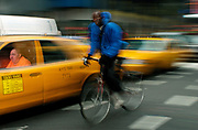 This image is a part of a series of images by Emile Wamsteker of people passing through Times Square and its environs.