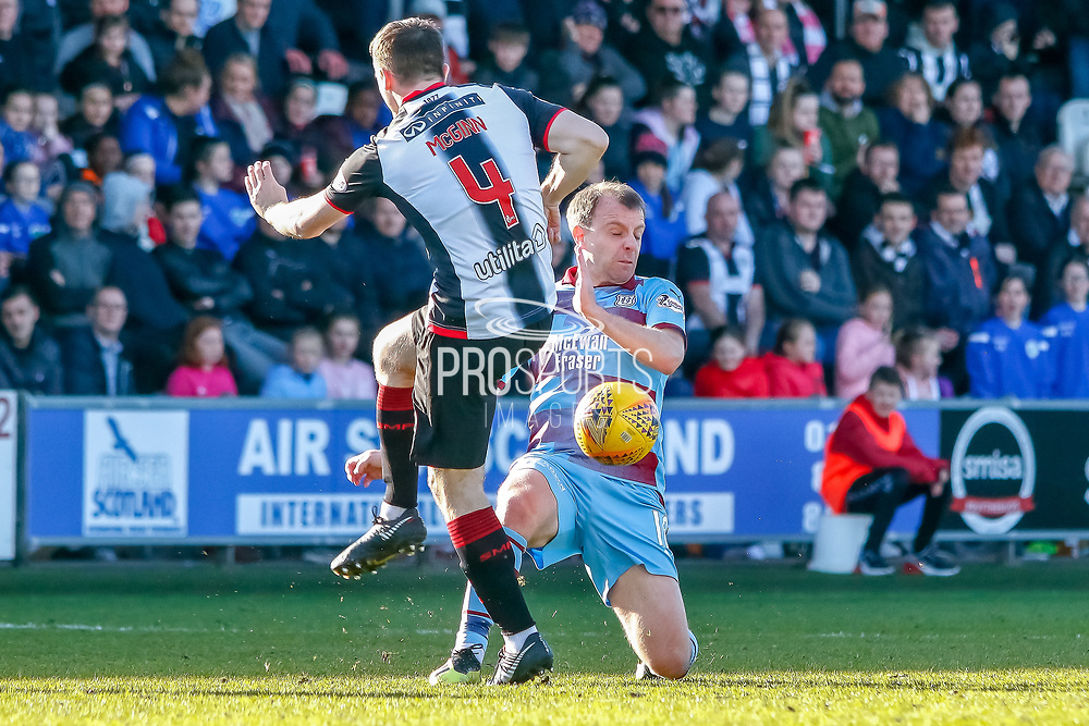 Scott Wright of Dundee FC takes one for the team as Stephen McGinn of St Mirren fires the ball at him during the Ladbrokes Scottish Premiership match between St Mirren and Dundee at the Paisley 2021 Stadium, St Mirren, Scotland on 30 March 2019.