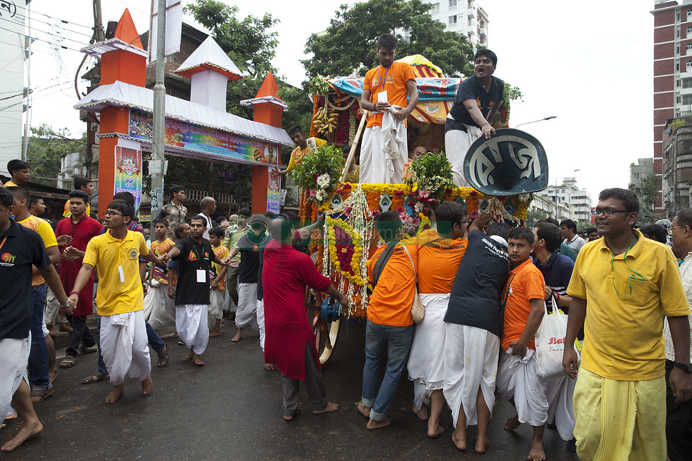 June 25, 2017 - Dhaka, Bangladesh - June 25, 2017- Dhaka, Bangladesh – Bangladeshi Hindu devotees attend in the annual festival of Rath Yatra, or chariot procession, in Dhaka, Bangladesh on June 25, 2017. The Ratha Yatra involves a public procession with a chariot with deities Jagannath (Vishnu avatar), Balabhadra (his brother), Subhadra (his sister) and Sudarshana Chakra (his weapon) on a ratha, a wooden deula-shaped chariot. It attracts over a million Hindu pilgrims who join the procession each year. © Monirul Alam (Credit Image: © Monirul Alam via ZUMA Wire)