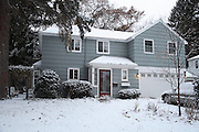 A home in winter.  This image was taken to have a visual photograph to compare with a matching infrared image.  This image is one of a set used to compare a house in visible light to infrared light (heat).
