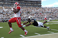 Houston cornerback Brandon Wilson (26) scores a touchdown past Central Florida quarterback Justin Holman (13) after stripping the ball from wide receiver Cam Stewart during the first half of an NCAA college football game in Orlando, Fla., Saturday, Oct. 24, 2015. (Photo/Phelan M. Ebenhack)