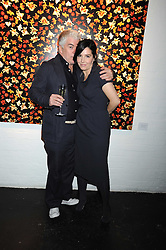 SHARLEEN SPITERI and TIM BLANKS at an exhibition entitled 'Cut Flowers' by Robin Derrick held at 70a Silverthorne Road, London SW8 on 8th October 2008.