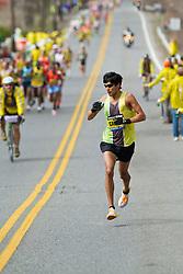 2013 Boston Marathon: Fernando Cabada takes fluids at water station