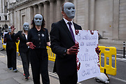 "Climate Change activists take their Environmental and Economy protest called 'The Walk of Shame' to the City of London, the capital's financial district , on 4th September 2020, in London, England. According to XR, ""companies and institutions have profited from the slave trade and the profit from the exploitation of people and the planet. Companies on their tour of City insitutions such as Lloyds of London, Aviva Insurance and the Bank of England, are financing and insuring major fossil fuel projects, fuelling the climate and ecological emergency."""