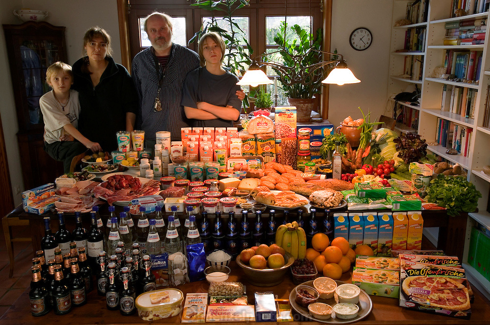 The Melander family: Jörg, 45, and Susanne, 43, with sons Kjell, 10, and Finn, 14 in the dining room of their home in Bargteheide, Germany, with a week's worth of food. From the book Hungry Planet: What the World Eats (Model Released)