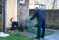 Police with a sniffer dog arrive to search the New Ash Green, Kent, home of the former partner of a mother who went missing over two months ago, after his re-arrest on suspicion of murder. New Ash Green, Kent, December 20 2018.
