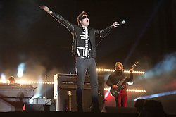 © London News Pictures. 25/08/2012. Reading, UK. Lead singer Tom Meighan performing with Kasabian on Day two of Reading Festival 2012 in Reading, Berkshire, UK on August 25, 2012. The three day event which attracts over 80,000 music fans opens officially today (Friday) and will headline The Cure, Kasabian and The Foo Fighters Photo credit : Ben Cawthra/LNP