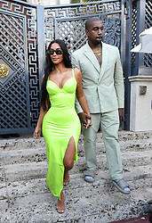 Kim Kardashian and Kanye West leave a wedding ceremony and stop for ice cream at Haagen Daaz before heading to the reception in Miami Beach, Florida. The couple showed plenty of PDA as Kanye insisted on lifting Kim out of the oversized Mercedes each time they stopped, placing a hand on her butt afterwards. 18 Aug 2018 Pictured: Kim Kardashian West; Kanye West; Kim Kardashian. Photo credit: MEGA TheMegaAgency.com +1 888 505 6342