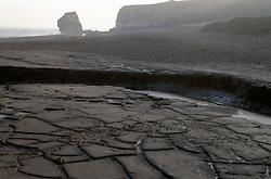 Coal slurry sediment on beach Co Durham UK