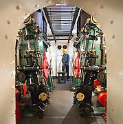 ****COPY HERE****  (https://www.dropbox.com/s/5mg81qiiuy22tre/adamson.rtf?dl=0)   © Licensed to London News Pictures. 02/12/2014. Liverpool , UK . Volunteer John Churchill works in the partially restored engine room. The only surviving steam powered tug tender, the Daniel Adamson, is being completely renovated by a team of volunteers in Liverpool. The vessel, which has had 90,000 man hours already spent on it, was bought for only one pound is the awaiting the decision of the Heritage Lottery Fund on an application of £3.6m to bring her back to her full glory.  . Photo credit : Stephen Simpson/LNP<br /> <br /> COPY HERE https://www.dropbox.com/s/5mg81qiiuy22tre/adamson.rtf?dl=0