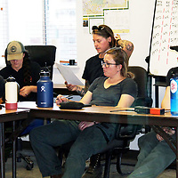 Members of a Women in Wildfire crew is briefed at Smokey Circle in Grants prior to going out to the Mount Taylor Fire.