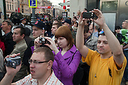 Moscow, Russia, 09/05/2010..Crowds gather in the early morning to watch Russian military vehicles and weaponry on their way through central Moscow to Red Square for the Victory Day parade, the largest ever.