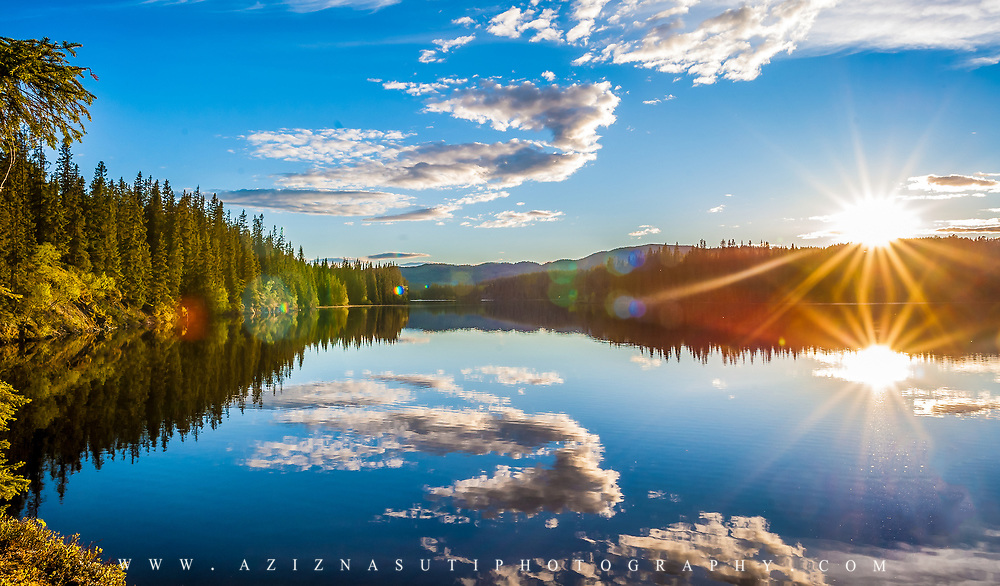 Reflection over the beautiful lake of Leirsjøen in Trondheim.   Store Leirsjøen or Greater Leirsjøen located in Leirelvvassdraget in Trondheim Bymark . Leirsjøen was originally separated from Frøset lake in the east, but by damming in 1929 floated the waters.d