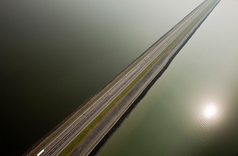 Nederland, Friesland, Gemeente Wonseradeel, 28-04-2010; Afsluitdijk ter hoogte van Breezanddijk, (voormalig werkeiland Breezand). Gezien naar de kust van Noord-Holland, IJsselmeer (l), Waddenzee (r)..Enclosure Dam at the height of Breezanddijk (former 'work island' Breezand), seen in the direction of Noord-Holland, IJsselmeer lake (l), the Wadden Sea (r)..luchtfoto (toeslag), aerial photo (additional fee required).foto/photo Siebe Swart