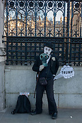 Outside Britains Palace of Westminster parliament, a Charlie Chaplin character making a Donald trump joke, on the day of Trumps inauguration as the 45th US president, on 20th January, in Parliament Square, London borough of Westminster, England.