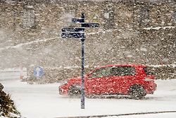 © Licensed to London News Pictures. 06/04/2021. Llanberis, Conwy, Wales, UK.A blizzard hits Pen-Y-Pass in Snowdonia National Park, in Conwy, Wales, UK. Photo credit: Graham M. Lawrence/LNP