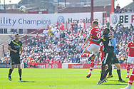 Cauley Woodrow of Barnsley (9) heads above Anthony Grant of Shrewsbury Town (42) during the EFL Sky Bet League 1 match between Barnsley and Shrewsbury Town at Oakwell, Barnsley, England on 19 April 2019.