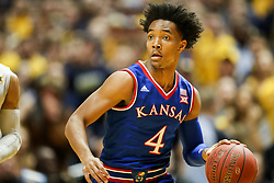 Jan 15, 2018; Morgantown, WV, USA; Kansas Jayhawks guard Devonte' Graham (4) dribbles the ball up the floor during the first half against the West Virginia Mountaineers at WVU Coliseum. Mandatory Credit: Ben Queen-USA TODAY Sports