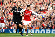 Alexis Sanchez of Arsenal (R) battles with Mike Van Der Hoorn of Swansea City (L). Premier league match, Arsenal v Swansea city at the Emirates Stadium in London on Saturday 28th October 2017.<br /> pic by Steffan Bowen, Andrew Orchard sports photography.