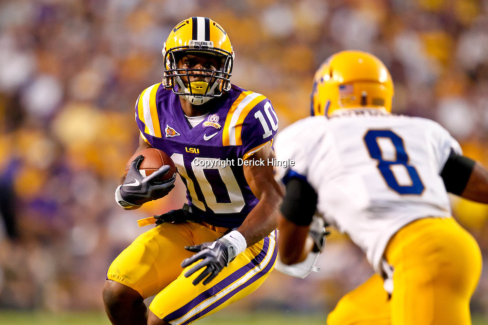 October 16, 2010; Baton Rouge, LA, USA; LSU Tigers wide receiver Russell Shepard (10) is pursued by McNeese State Cowboys cornerback Seth Thomas (8) during a game at Tiger Stadium. LSU defeated McNeese State 32-10. Mandatory Credit: Derick E. Hingle