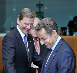 """Nicolas Sarkozy, France's president, right, shares a laugh with Guido Westerwelle, Germany's new foreign minister, during the European Union Summit at the EU headquarters in Brussels, Belgium, on Thursday, Oct. 29, 2009. European Union leaders are set for """"very difficult"""" talks to overcome the Czech Republic's resistance to a new governing treaty designed to strengthen the EU's influence in world affairs, Reinfeldt said. (Photo © Jock Fistick)"""