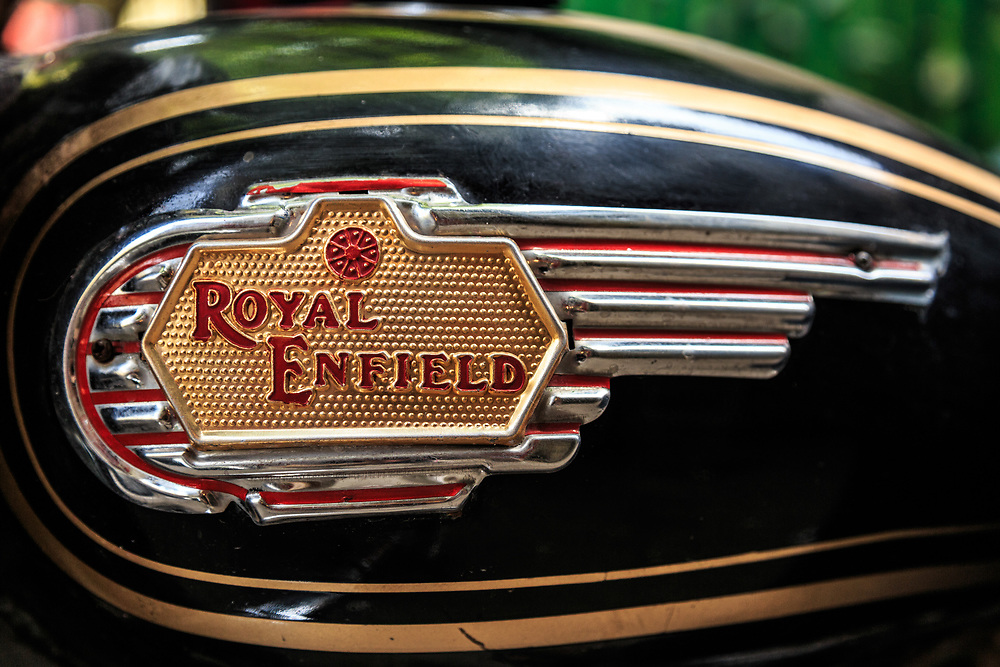The Royal Enfield tank sign in Delhi, India. Royal Enfield was the brand name under which the Enfield Cycle Company (founded 1893) manufactured motorcycles in England. Enfield of India continues producing motorcycles under the Royal Enfield name in India.
