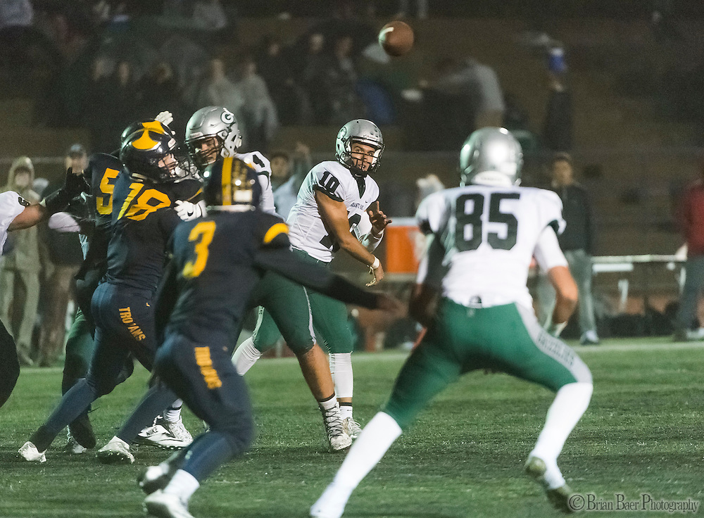 Granite Bay Grizzlies Jade Foddrill (10), passes the ball during the fourth quarter as the Oak Ridge High School Trojans host the Granite Bay Grizzlies, Friday Oct 14, 2016. The Oak Ridge Trojans won the game 28-0.<br /> photo by Brian Baer