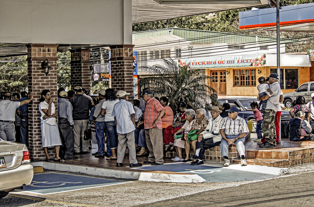 Folks lined up to collect their Social Security payments in Boquette, Pananma.