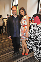 NICHOLAS KIRKWOOD and FREIDA PINTO at the opening party for Nicholas Kirkwood's new store at 5 Mount Street, London on 12th May 2011.