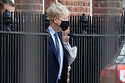 © Licensed to London News Pictures. 30/04/2021. London, UK. Prime Minister Boris Johnson wears a face mask as he departs the rear of Downing Street.  Photo credit: George Cracknell Wright/LNP