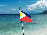 Filipino flag floats above turquoise waters, Mindoro Island, Philippines, Southeast Asia, 2016