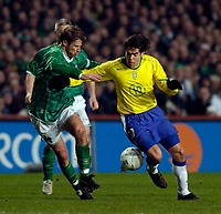 Photo. Jed Wee.<br /> Republic of Ireland v Brazil, International Friendly, Lansdowne Road, Dublin. 18/02/2004.<br /> Brazil's Kaka (R) tries to get the better of Ireland's Kenny Cunningham.