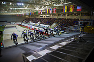 Riders charge down the start ramp at the UCI BMX Supercross World Cup in Manchester, UK