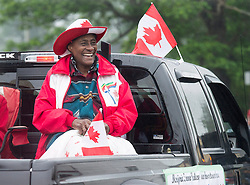 Lockeport native Marjorie Turner-Bailey, parade grand marshall, smiles as she participates in Canada 150 events in Lockeport, N.S. on Saturday, July 1, 2017. Turner-Bailey a descendant of black Loyalists, competed in track and field in the 1976 Montreal Olympics. Photo by Andrew Vaughan/CP/ABACAPRESS.COM