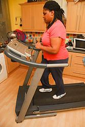 Portrait of black woman on a treadmill.