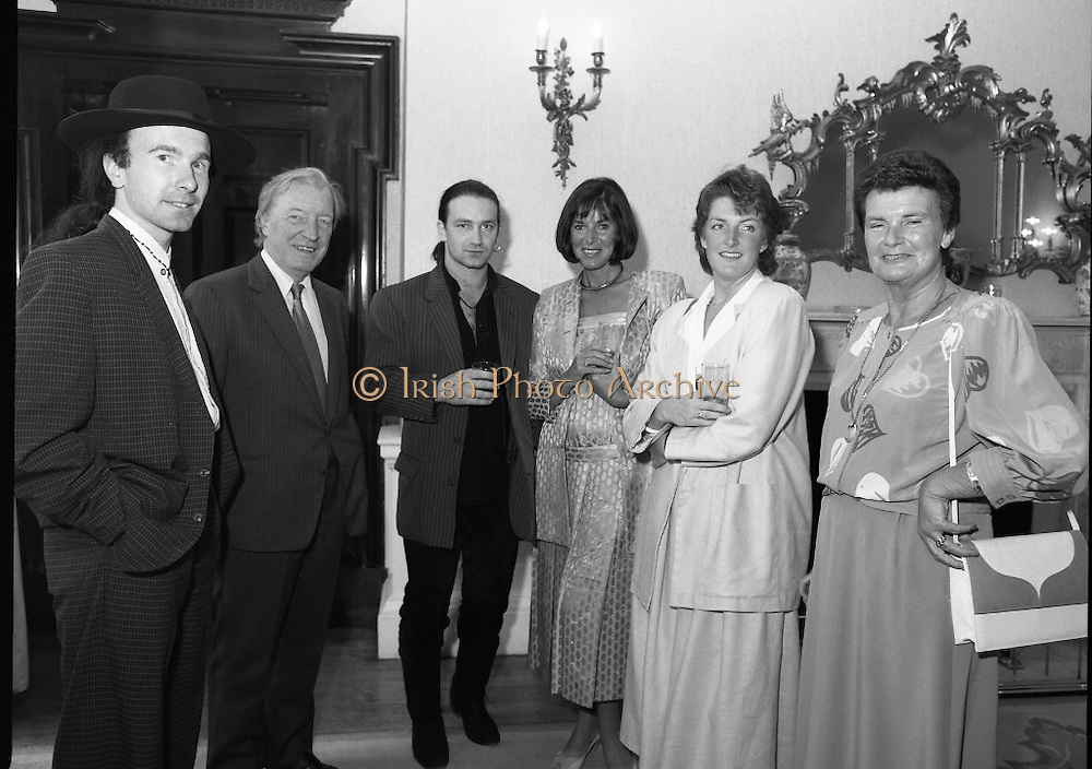 U2 Meet An Taoiseach, Charles Haughey.    (R58)..1987..18.05.1987..05.18.1987..18th May 1987..After their highly successful tour of America, An Taoiseach, Charles Haughey welcomed U2 back to Ireland with a reception held in Iveagh House, Dublin. Iveagh House formerly a home to the Guinness family is now held by the Department of Foreign Affairs...A group photograph taken at the U2 reception in Iveagh House.