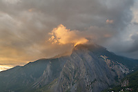 The French Alps near the Italian boarder are lit up at sunset with a bronze light usually found only in paintings.